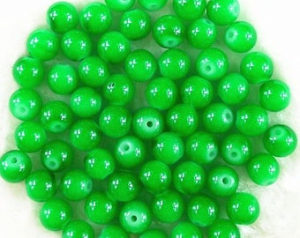 Set of 6 round green glass beads - 6mm