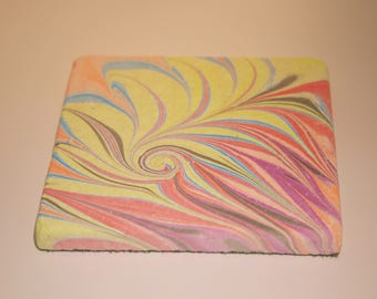 Hand marbled stone tile with fountain/twirl design.(004)