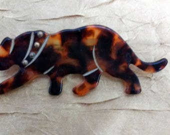 Tortoise shell lucite tiger or leopard brooch with carved features
