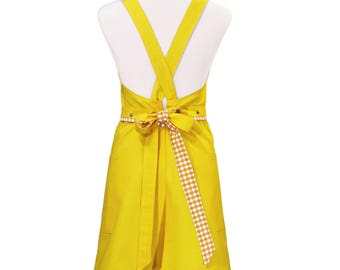 Woman in yellow cotton apron