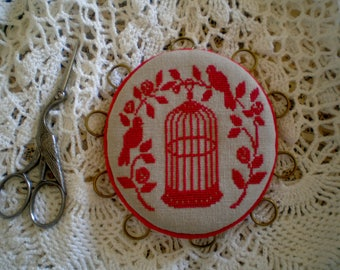 Thread keeper and door pins embroidered red bird and Cage