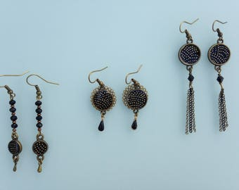 Earrings black Japanese paper with gold dots.