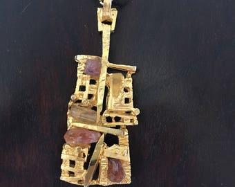 Fabulous brutalist pendant with uncut quartz stones
