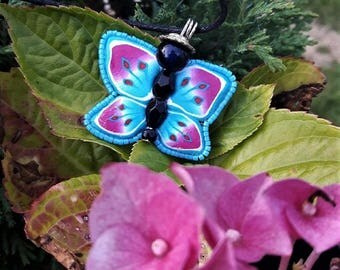 Blue, pink butterfly necklace made of polymer clay and beads.