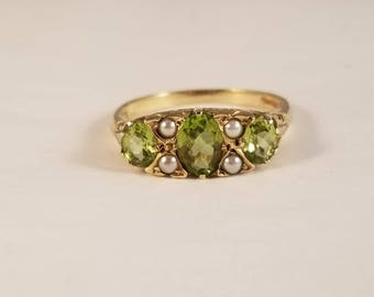 Vintage peridot and pearl ring in yellow gold