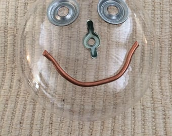 Funny Faced Unibrow Round Ornament Made With Recycled Hardware Pieces