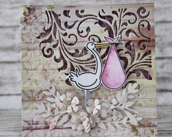 Mixed media new baby card with stork and pink flowers - baby girl