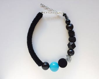Black necklace with blue detail.