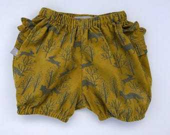 "Eddie & Bee baby corduroy Ruffle bum bloomers in Mustard ""Winter woodland"" print."