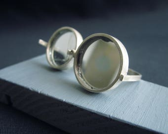 I'm Fine. Hinged ring with perfect mirror which hides damaged mirror beneath.