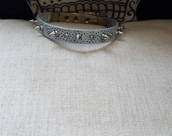 Silver leather choker with spike rivets and unique closure