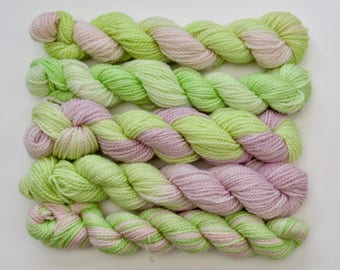 Set of five 20g mini skeins on a merino and bamboo blend 4ply knitting wool yarn in yellows, pinks and greens