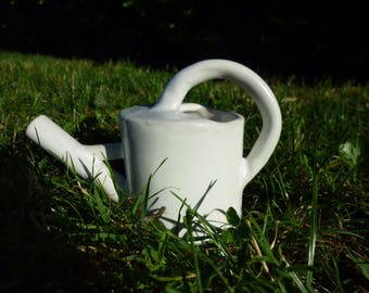 Decorative watering can in white stoneware