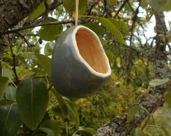 Gray-green ceramic bird feeder