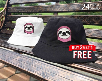 Pink Sloth Embroidered Bucket Hat by 24PlanetsStudio