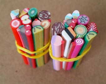Set of 10 polymer clay sweets and fruit canes for scrapbooking, nail art, jewelry making and other creative work.