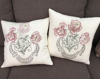 Pair of embroidered cushions