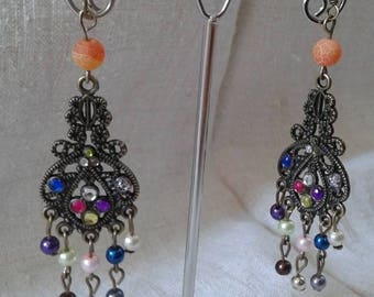 multicolored beads and bronze earrings