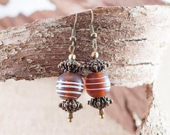Stylish brown earrings with handmade tibetan glass beads