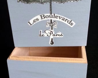 box out of wooden painted in a blue gray tone