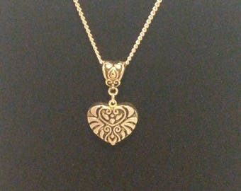 Sterling silver chain with heart pendant