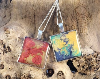 Stunning pendants, multi-coloured gold and red or blue, yellow and green - Pebeo and resin in a square bezel tray on a delicate chain