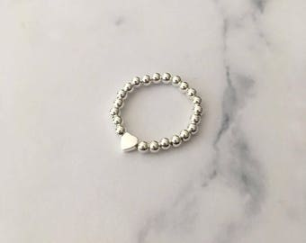 Sterling Silver stretch ring with Heart bead
