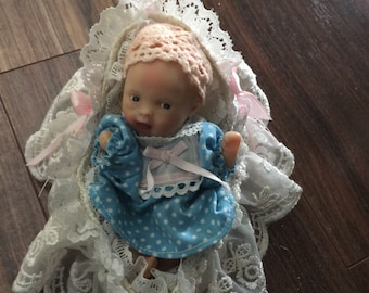 Adorable little baby doll in crib must see