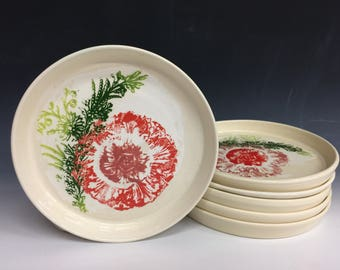 Set of five dinner plates