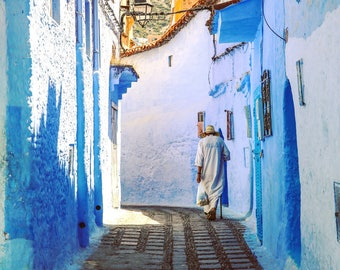 Old man in the medina of the blue town