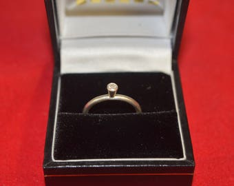 An elegant Diamond and Sterling Silver Ring.