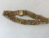 15k carat gold unusual antique victorian gold gate charm bracelet with turquoise and seed pearls
