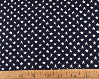 White stars on navy blue background cotton fabric by the yard