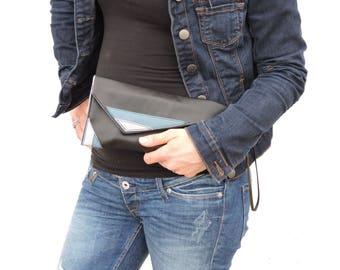 geometique black faux leather hand bag