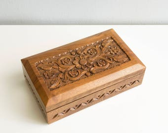 Hand carved wooden jewelry box flowers.