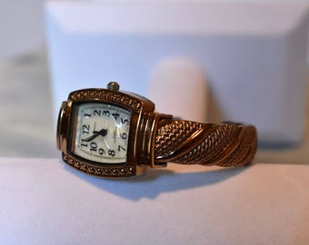 Watch-Vintage Ladies Copper-Gold Bangle Spring Action Band and Mother of Pearl Dial