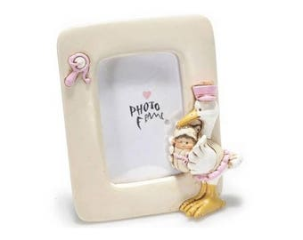 Picture frame with pink Stork and baby