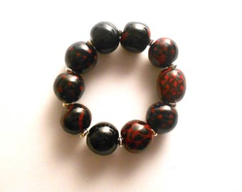 Elegant black and red Kazuri fair trade hand made and hand painted bracelet  with ceramic beads.
