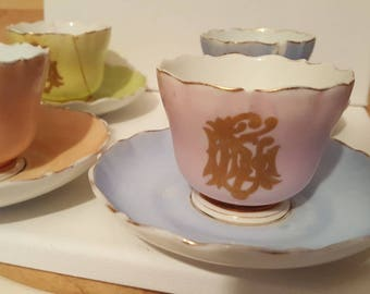 Meissen tea cups and saucers, pretty pastel colours with gold monogramme