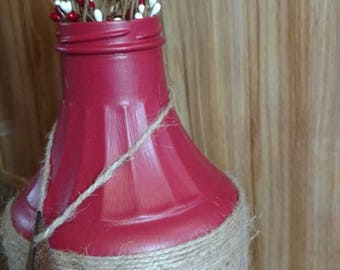 Painted glass bottle, mid section is wrapped with jute.