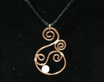 Hammered Copper spiral with glass pearl bead