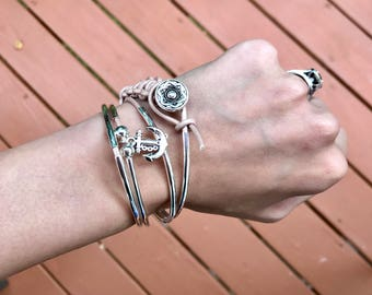 Leather silver wrap charm bracelet