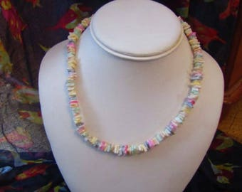 Rainbow coloured beaded choker type necklace with twist fastening