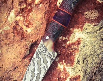 Custom handmade survival knife made from a N690 stainless steel with custom kydex sheath