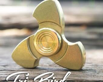 The Tri-bird Fidget Spinner in Brass with Brass buttons