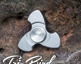 The Tri-bird Fidget Spinner in Stainless Steel with Stainless Steel buttons