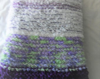 Shades of purple and white striped hand knit baby or toddler blanket.  45 inches x 48 inches