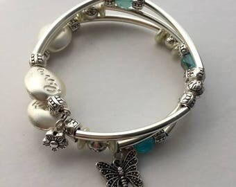 Aqua blue and silver Memory wire bracelet with 2 charms.