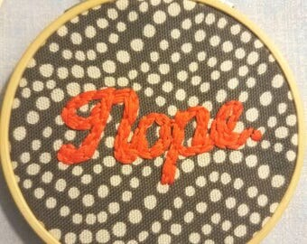 Nope. Hand embroidered wall art.