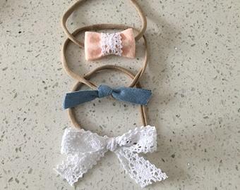 Trio of earrings on elastic headband